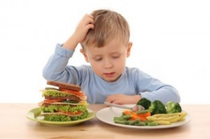 Young boy looking at healthy food